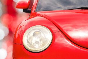 headlight of a red vw beetle